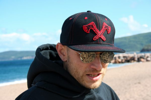 Canadian Lumber flat brim black snapback hat, customizable, 80% wool, 20% acrylic, 3 layer stitching and custom red ax logo, outdoors