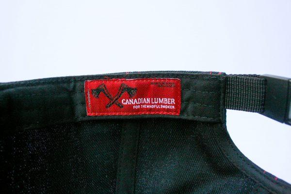 Canadian Lumber flat brim black snapback hat, customizable, 80% wool, 20% acrylic, 3 layer stitching and custom red ax logo, interior stitching closeup