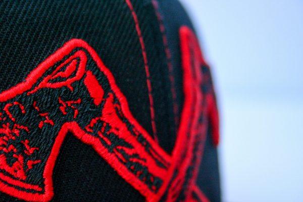 Canadian Lumber flat black snapback hat, customizable, 80% wool, 20% acrylic, 3 layer stitching and custom red ax logo, closeup