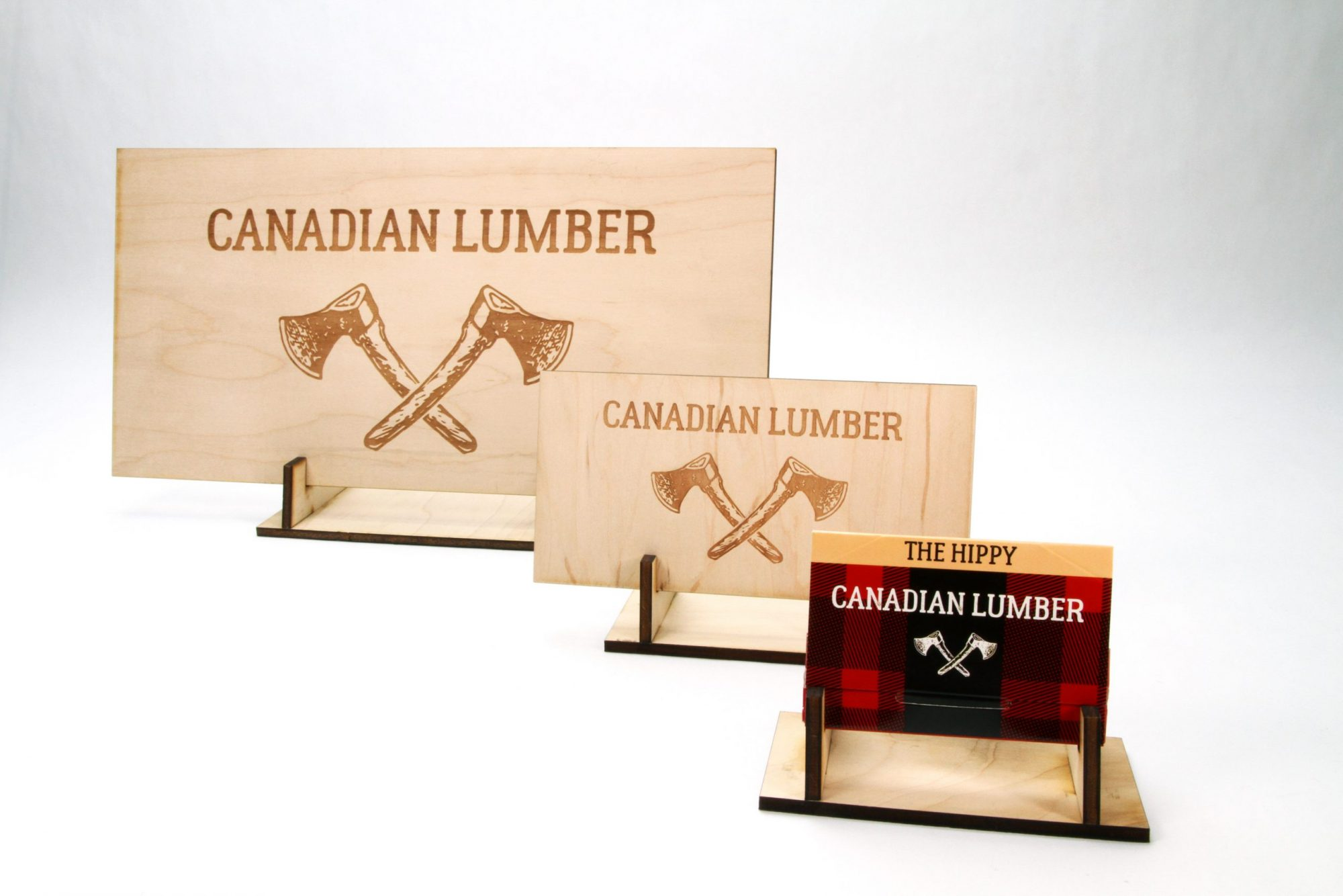 Canadian Lumber Ltd. laser-etched wooden sign with emblazoned double ax logo, Canada's top cannabis accessory brand