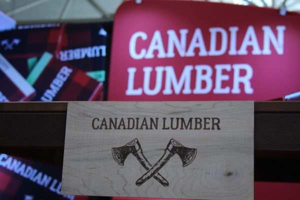 Canadian Lumber Ltd. laser-etched wooden sign with emblazoned double ax logo in action, Canada's top cannabis accessory brand