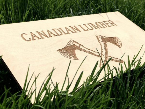 Canadian Lumber Ltd. laser-etched wooden sign with emblazoned double ax logo side view, Canada's top cannabis accessory brand